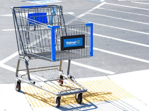 SACRAMENTO USA - SEPTEMBER 13: Walmart shopping cart on September 13 2013 in Sacramento California. Walmart is an American multinational retail corporation that runs chains of large discount department stores